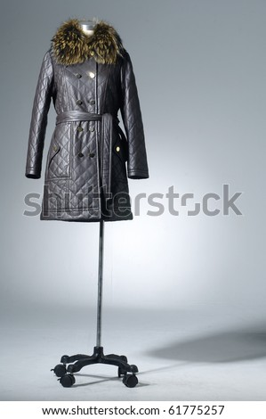 Female fur coat o on mannequin isolated light background