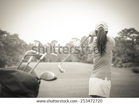 Female golfers are hitting the ball into the goal,vintage style - stock photo