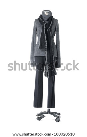 female gray dress and trousers with black scarf on n mannequin