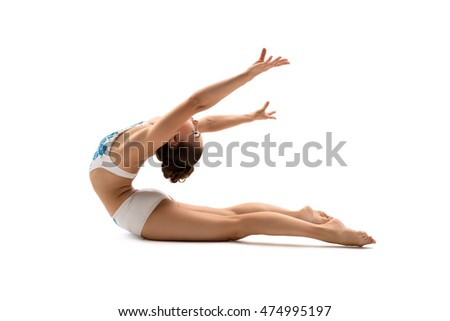 Female gymnast posing while bending her back
