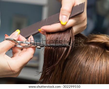 Female hair cutting scissors in a beauty salon - stock photo