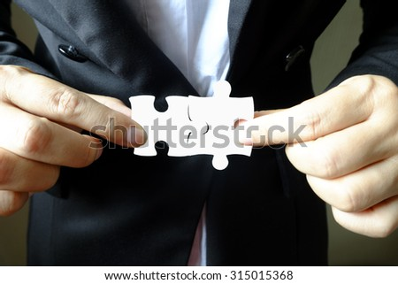 Female hand and puzzle ,Business concept