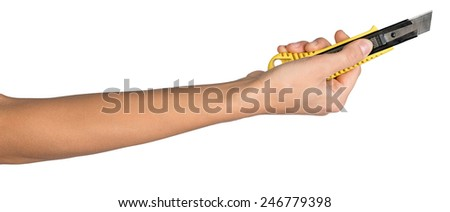 Female hand, bare, holding cutter knife, isolated over white background - stock photo