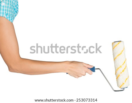 Female hand, bare, holding paint roller, isolated over white background - stock photo