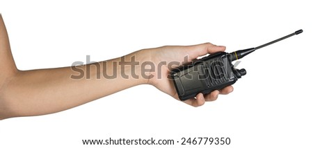 Female hand, bare, holding portable radio transmitter, isolated over white background - stock photo