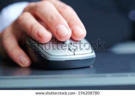female hand clicking computer mouse - stock photo