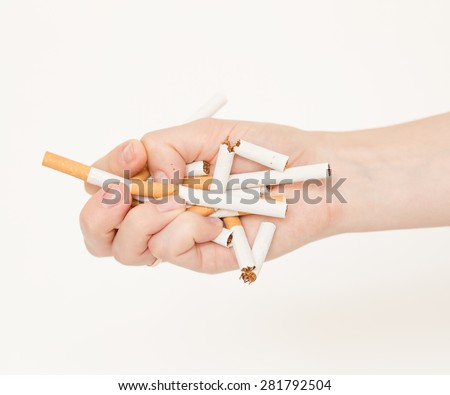 female hand destroying cigarettes - stop smoking concept