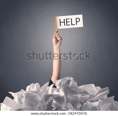 female hand emerging crumpled paper pile stock photo  female hand emerging from crumpled paper pile holding help sign