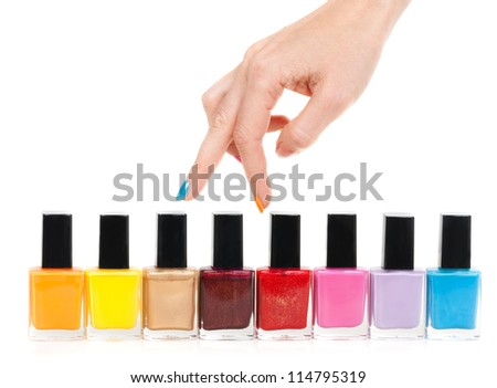 Female hand fingers are the colored paints polish on a white background