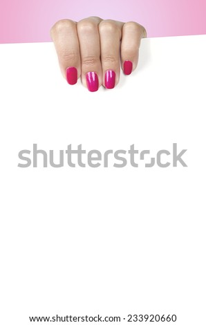 Female hand holding a blank white panel. On a pink background - stock photo