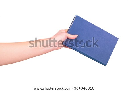 Female hand holding a book isolated on a white background - stock photo