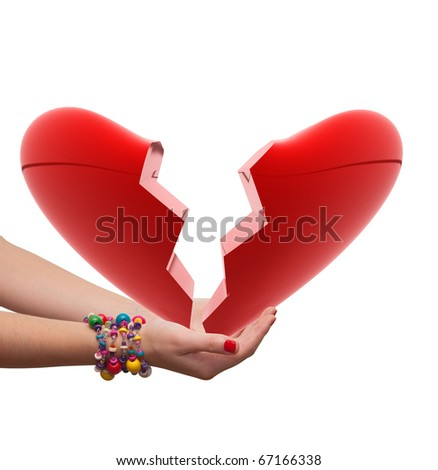 female hand holding a broken heart - stock photo