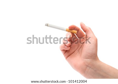 Female hand holding a cigarette over a white background - stock photo