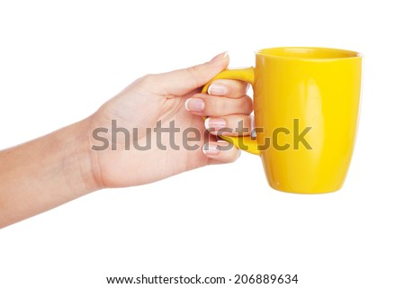 Female hand holding a cup on white background