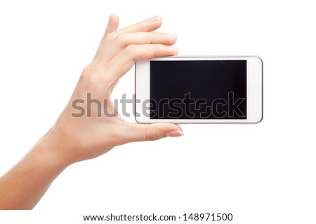 Female hand holding a modern smartphone - stock photo