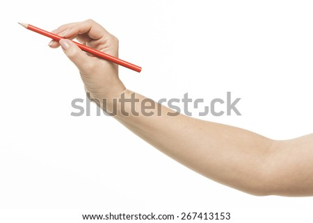 Female hand holding a pencil, isolated on white