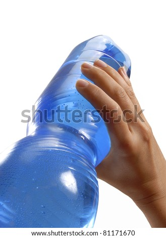 Female hand holding a plastic mineral water bottle. Drinking mineral water. - stock photo