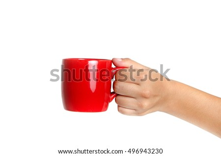 Female hand holding a red cup
