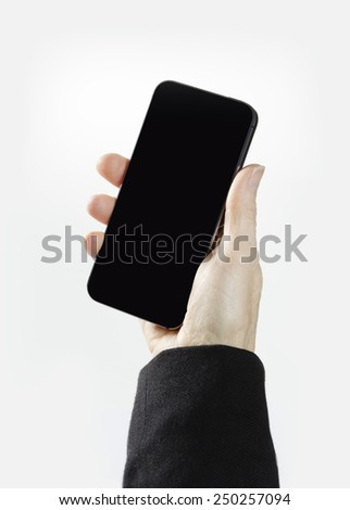 Female hand holding a smart phone - stock photo