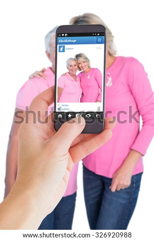 Female hand holding a smartphone against photo sharing app - stock photo