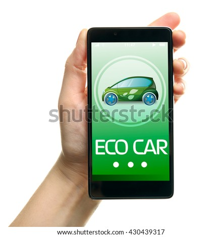 Female hand holding a smartphone isolated on white. Eco car concept