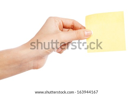 Female hand holding a sticky note, white background