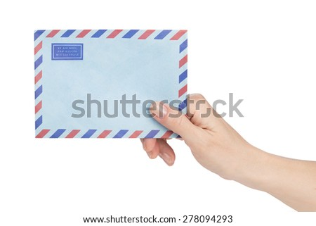 female hand holding air mail envelope over white