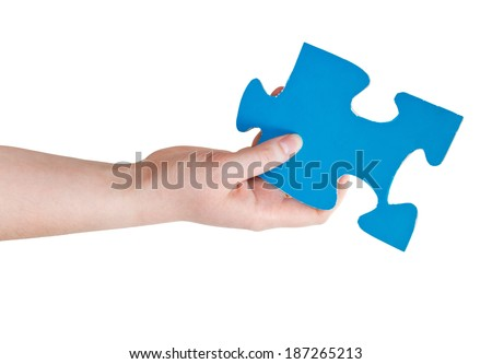 female hand holding big blue paper puzzle piece isolated on white background