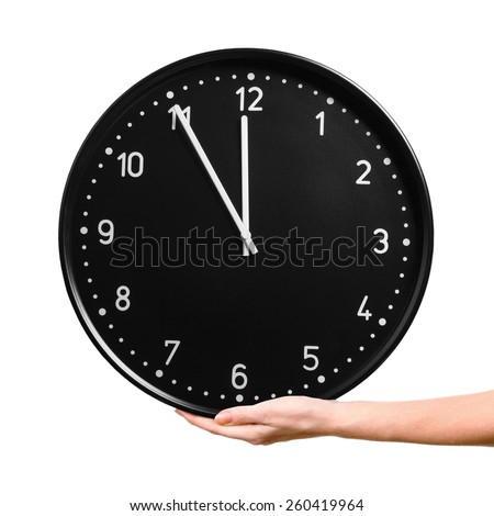 Female hand holding big clock isolated on a white background. Time concept - stock photo