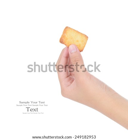 female hand holding biscuits isolated on white background