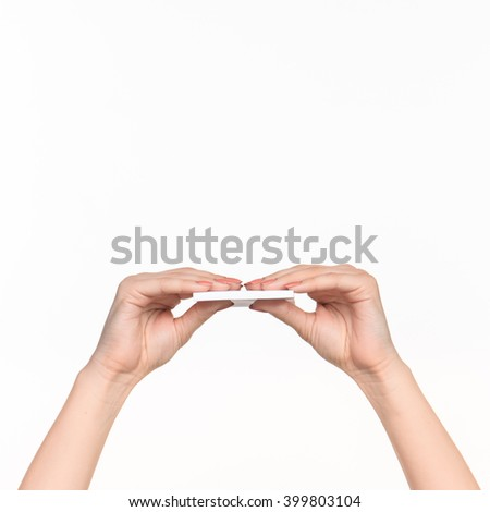 Female hand holding blank paper for records on white. - stock photo