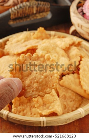 Female hand holding chrysanthemum  shape  biscuits