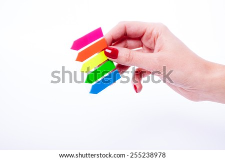 Female hand holding color tabs isolated on a white background - stock photo