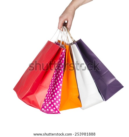 Female hand holding colorful shopping bags isolated with clipping path