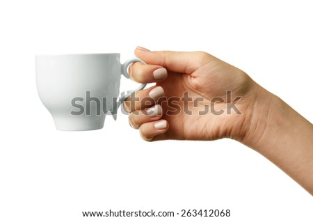 Female hand holding cup isolated on white - stock photo