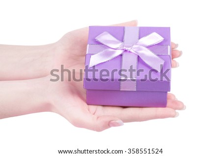female hand holding gift box  isolated on white background - stock photo