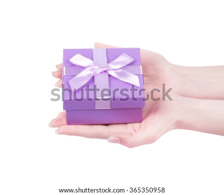 female hand holding gift box  isolated on white background