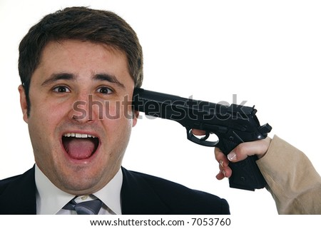 Female hand holding handgun on head scared businessman isolated on white background - stock photo