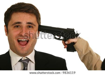 Female hand holding handgun on head scared businessman isolated on white background - stock photo