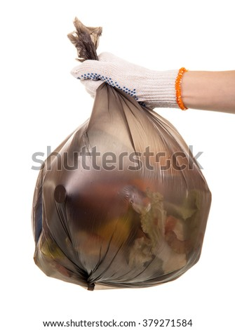 Female hand holding household waste package isolated on white background - stock photo