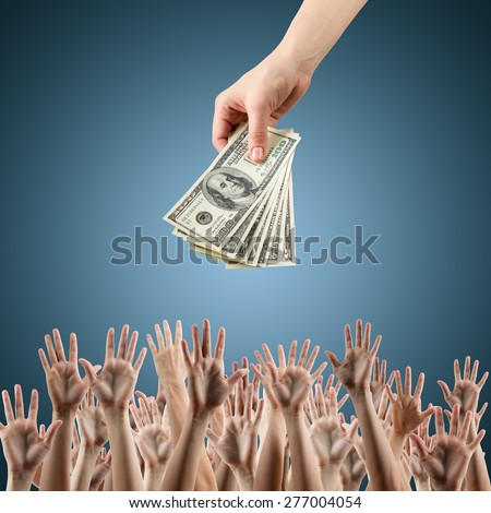 Female hand holding money dollars offering them many hands reaching out for earning money. Rich and poor concept. Competition in the labor job market. Line for unemployment benefits Blue background - stock photo