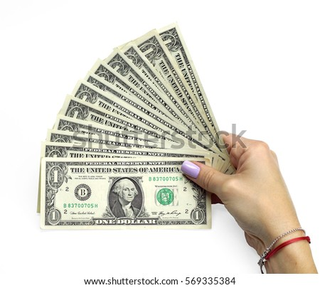 Female hand holding money dollars US