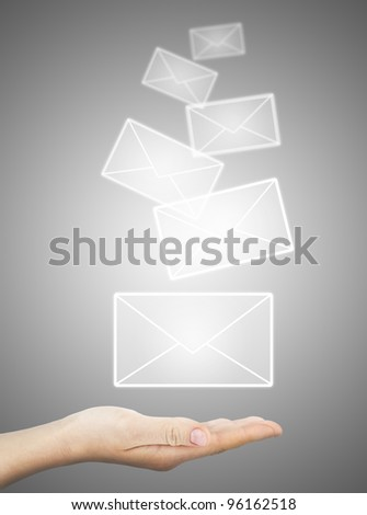female hand holding or getting e-mail sign on a touch screen interface over grey background - stock photo