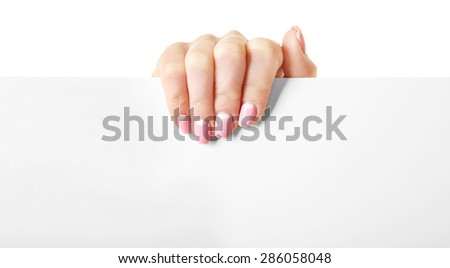 Female hand holding paper blank isolated on white