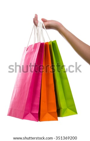 Female hand holding shopping bags, isolated on white  - stock photo