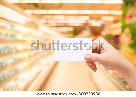 Female hand holding shopping credit card - stock photo