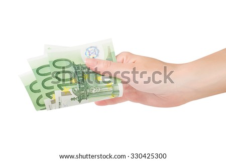 Female hand holding some euro banknotes isolated on white with clipping path