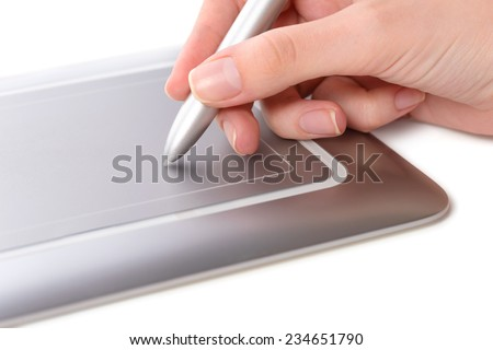 Female hand, holding stylus, making use of pen tablet, close-up shot, isolated on white background - stock photo