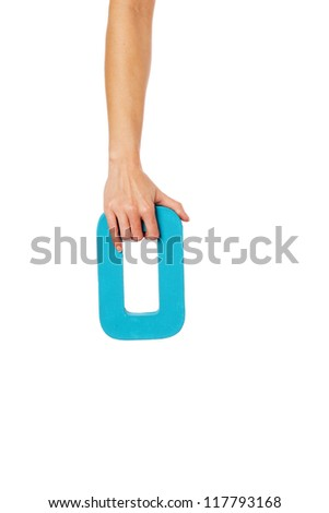 Female hand holding up the number 0 against a white background conceptual of numbers, measurement, amount, quantity, accounting and mathematics