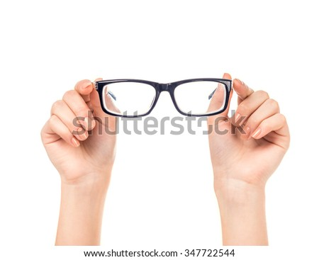 Female hand holds glasses isolated on a white background - stock photo